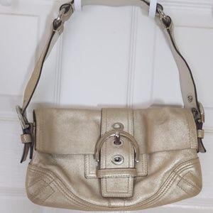 Sparkling soft gold coach purse
